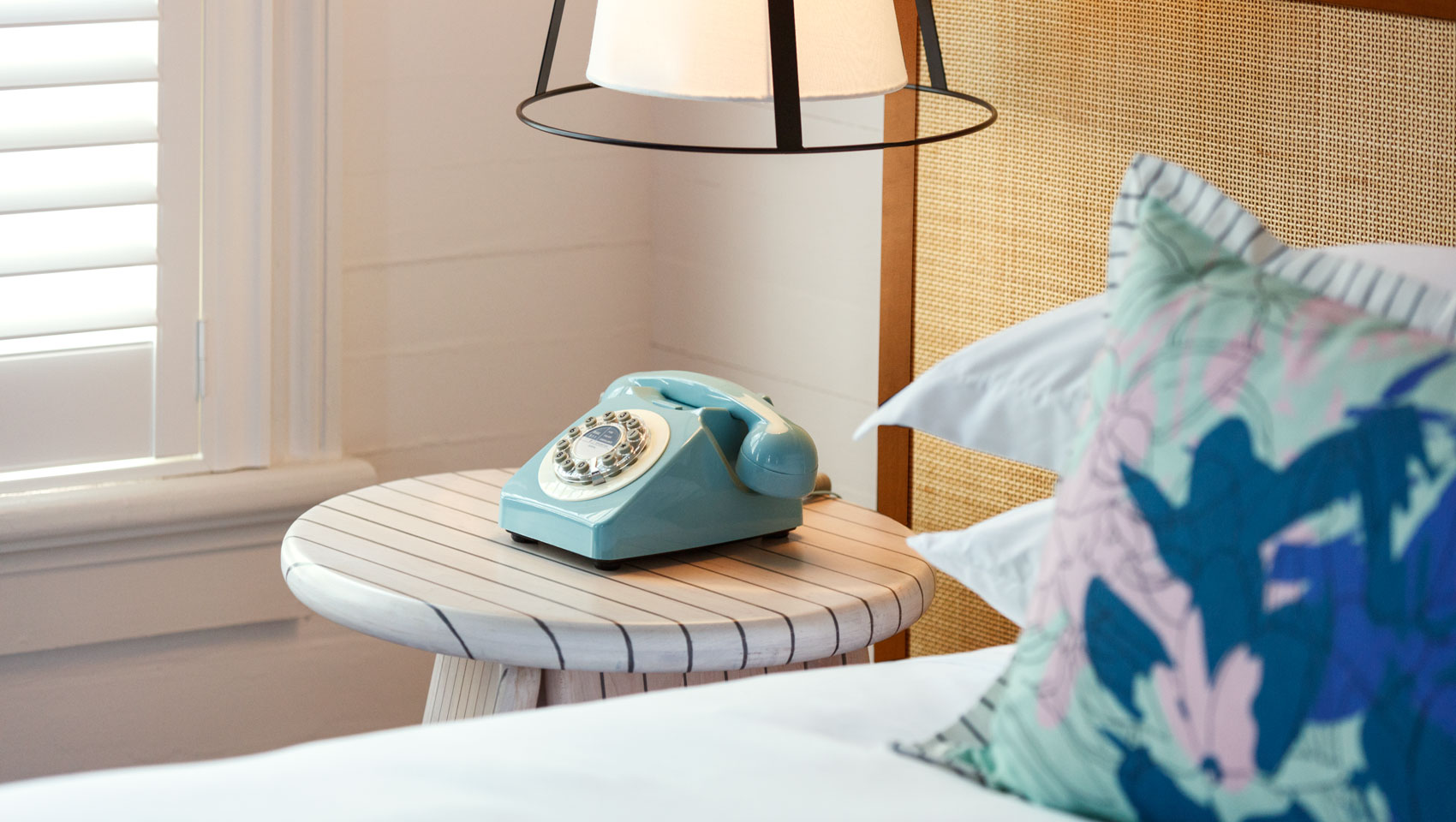 ridley house king guest room with side table and retro teal phone featured