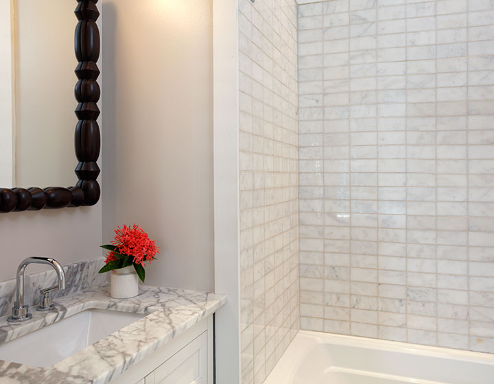 ridley house guest room bathroom with color tile and white vanity